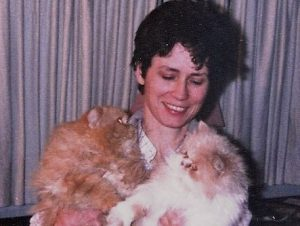 Samantha Mullen cuddling cats Me-Me and You-You.