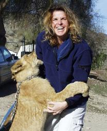 Dr. Jennifer Conrad of The Paw Project with lion cub.